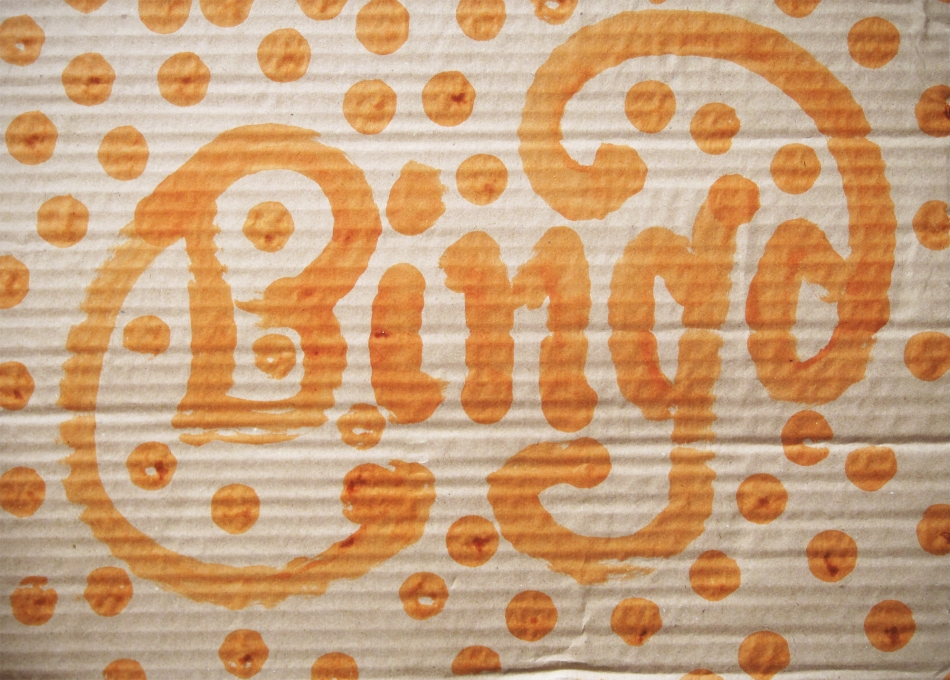 Bingo lettering in orange with dots surrounding it