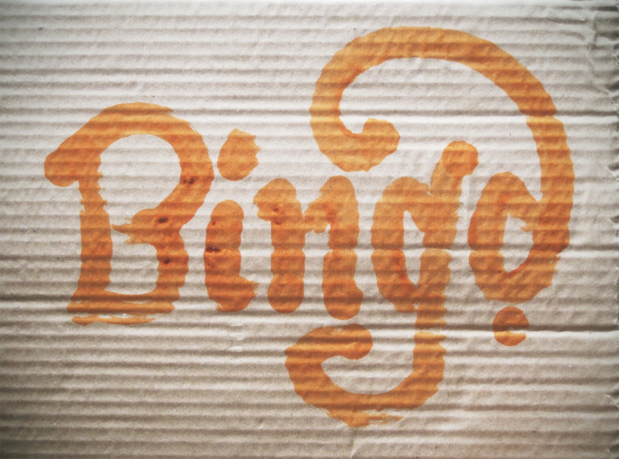 Bing as orange lettering on cardboard